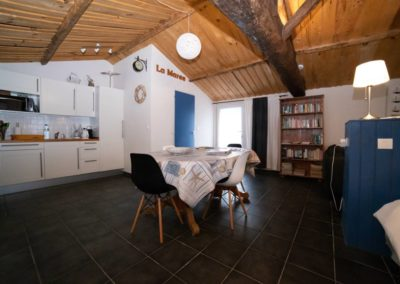 large table and kitchen in B&B room in France